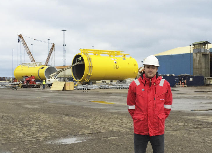 H. Pedersen in front of wind construction