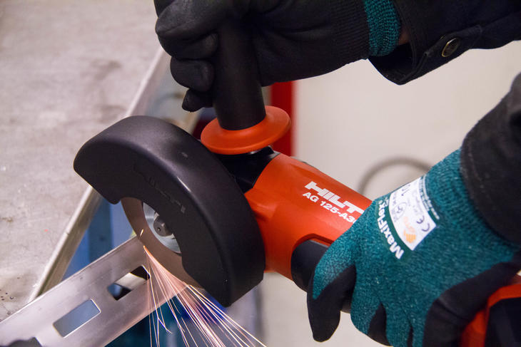 Cutting steel with Hilti angle grinder.
